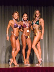 Bikini short class competitors, from left, Akiko Akimoto, Rhea Macaluso and Laurel Wilson display their medals at the 2015 Michelob Ultra Guam National Fitness Championships and International Invitational at the LeoPalace Resort ballroom on Saturday, Sept. 26, 2015.