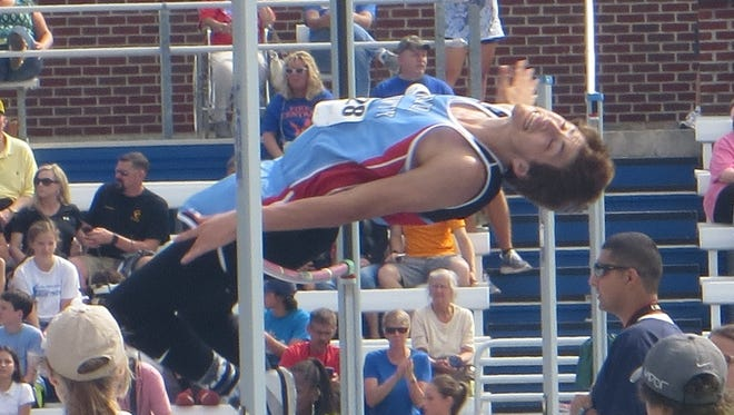 Tyler Cowan clears the jump at 5'8. Cowan tied for 15th at the state competition Friday in Lexington.