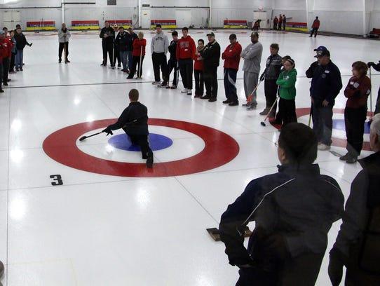 People get a demonstration as the Wausau Curling Club