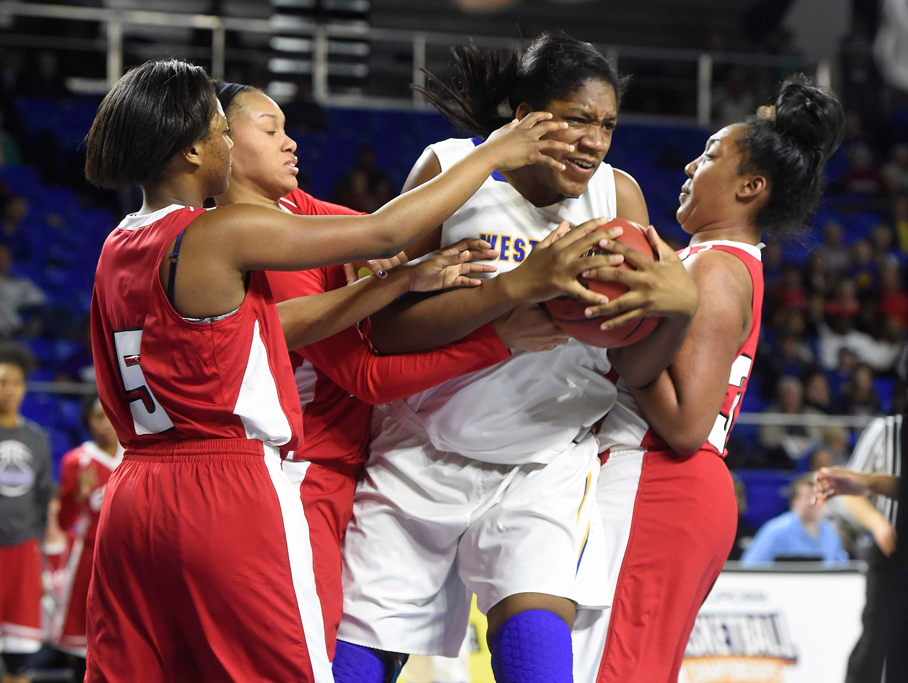 Westview's Deja Graves (55) fights for the ball against several East players as East Nashville wins over Westview High School 35-32 in the Division I Class AA Girl's basketball semi-finals at the Murphy Center on MTSU's campus March 11, 2016 in Murfreesboro, Tenn.