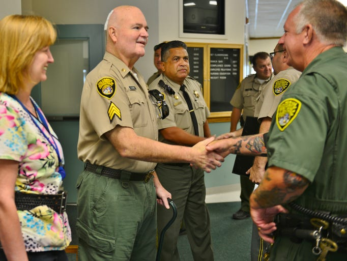Prison guards at the California Substance Abuse Treatment Facility and State Prison at Corcoran honored Tulare County women, Joanne Nabors and Jennifer Jutiron, Wednesday for saving a corrections sergeant who  nearly died after flipping his truck on Highway 198 and Akers Street in June.