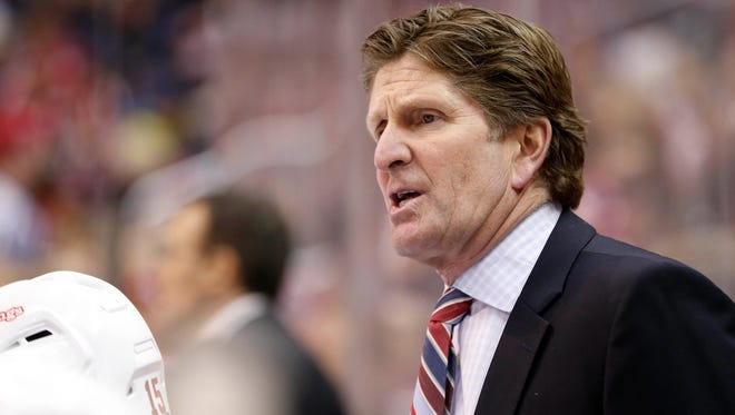 Detroit Red Wings coach Mike Babcock talks to his team from behind the bench against the Washington Capitals.