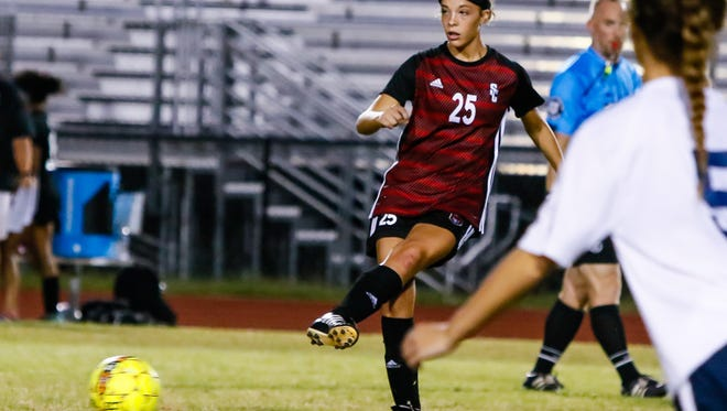 Stewarts Creek's Delaney Mitchell (25) fires a pass during Mondays match vs. Blackman. Mitchell scored a hat trick in a 4-1 win.