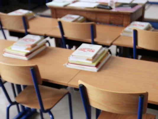 School books are seen on the tables of a