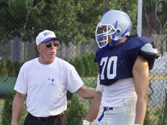 Vinnie Iachatta, Manasquan, gets instruction from assistant coach Don Reid in 2002.
