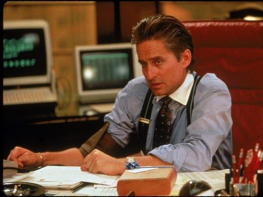 """Michael Douglas as 'Gordon Gekko' in a scene from """"Wall Street"""" (1987)."""