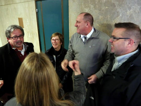 Tom Moran, center, is congratulated by family and supporters after charges against him were dismissed in Manhattan Supreme Court Feb. 5, 2018. Moran is a Metro-North conductor who was accused of assaulting MTA cops in August.