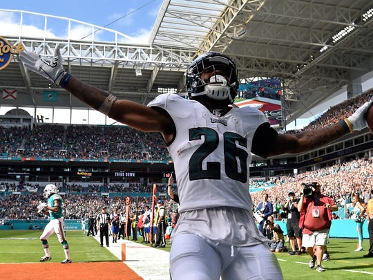 Dec 1, 2019; Miami Gardens, FL, USA; Philadelphia Eagles running back Miles Sanders (26) scores a touchdown in the first half against the Miami Dolphins at Hard Rock Stadium. Mandatory Credit: Steve Mitchell-USA TODAY Sports