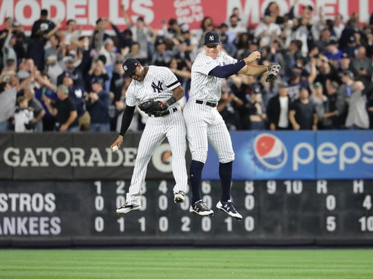 Aaron Hicks and Aaron Judge celebrate after the Yankees Game 5 victory over the Astros, Wednesday, October 18, 2017.