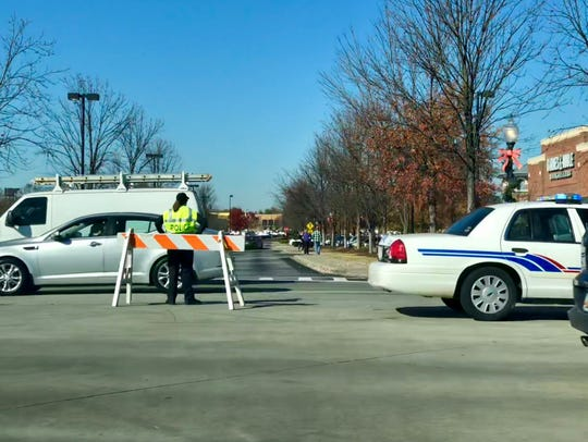 A police officer helps keep traffic moving near a shopping center on Woodruff Road during Black Friday last year.