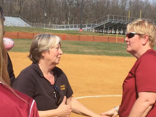 Hillsborough coach Cheryl Iaione (right) congratulates former Voorhees skipper Donna Exley, who was honored before Saturday's game at Voorhees High School