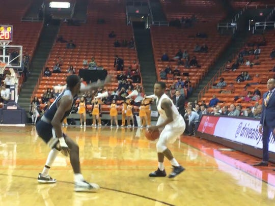 Nigel Hawkins looks for an opening against Rice on Saturday at the Don Haskins Center.