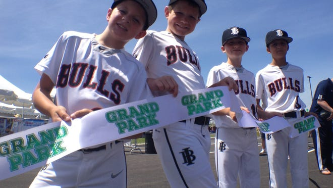 Baseball players from Lids Indiana Bulls 9U White get ready for the ribbon cutting for Westfield's Grand Park Grand Opening ceremony Saturday, June 21, 2014.