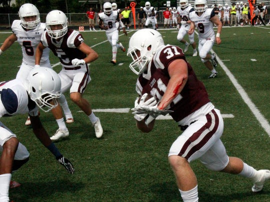 First Baptist Academy fullback Blane Briggs runs the ball against Fort Lauderdale-Westminster Academy in the teams' spring football game at First Baptist Academy in Naples on Saturday, May 21, 2016.