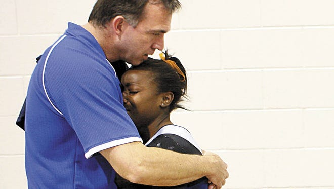 Former San Angelo Central High School gymnast Kaila Martin hugs coach Tony Walker during her illustrious career. Martin won 10 individual state titles in gymnastics and was on two state championship teams. She'll be inducted into the Bobcat Athletic Hall of Fame on Saturday, March 17, 2018 at the McNease Convention Center.