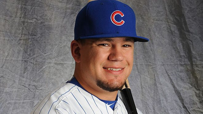 Kyle Schwarber, a former Indiana University player, gets to wear the real Chicago Cubs gear, at least for a few days.