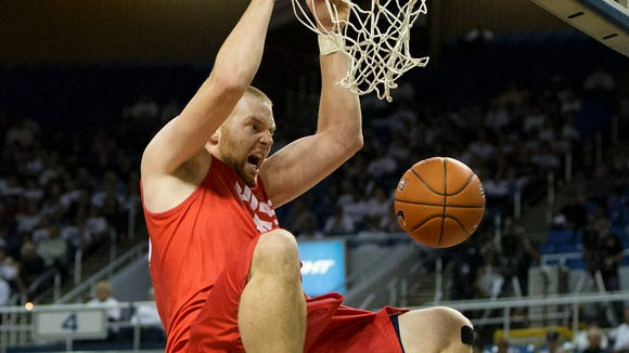 New Mexico's Alex Kirk dunks the ball against Nevada in the first half of their basketball game at Lawlor Events Center in Reno, Nevada on Sunday afternoon, March 2, 2014.