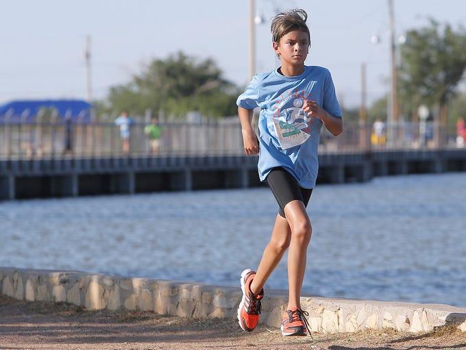 Adrian Prieto sprints to the finish line in the Sun
