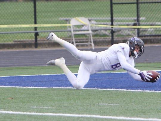 Cascade Christian's John Fralich scores a touchdown