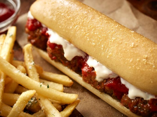 Olive Garden's new meatball breadstick sandwich will be offered starting June 1. The addition of breadstick sandwiches are just the latest attempt to revamp Olive Garden's menu and marketing as sales have declined for the past three of its fiscal years.
