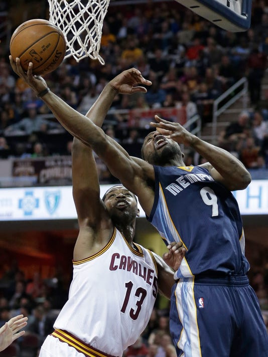 Memphis Grizzlies' Tony Allen (9) drives to the basket against Cleveland Cavaliers' Tristan Thompson (13) in the first half of an NBA basketball game Monday, March 7, 2016, in Cleveland. The Grizzlies won 106-103. (AP Photo/Tony Dejak)