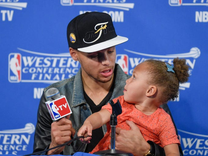 Golden State Warriors star Stephen Curry with his daughter