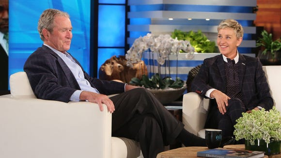 Ellen DeGeneres, right, and W.
