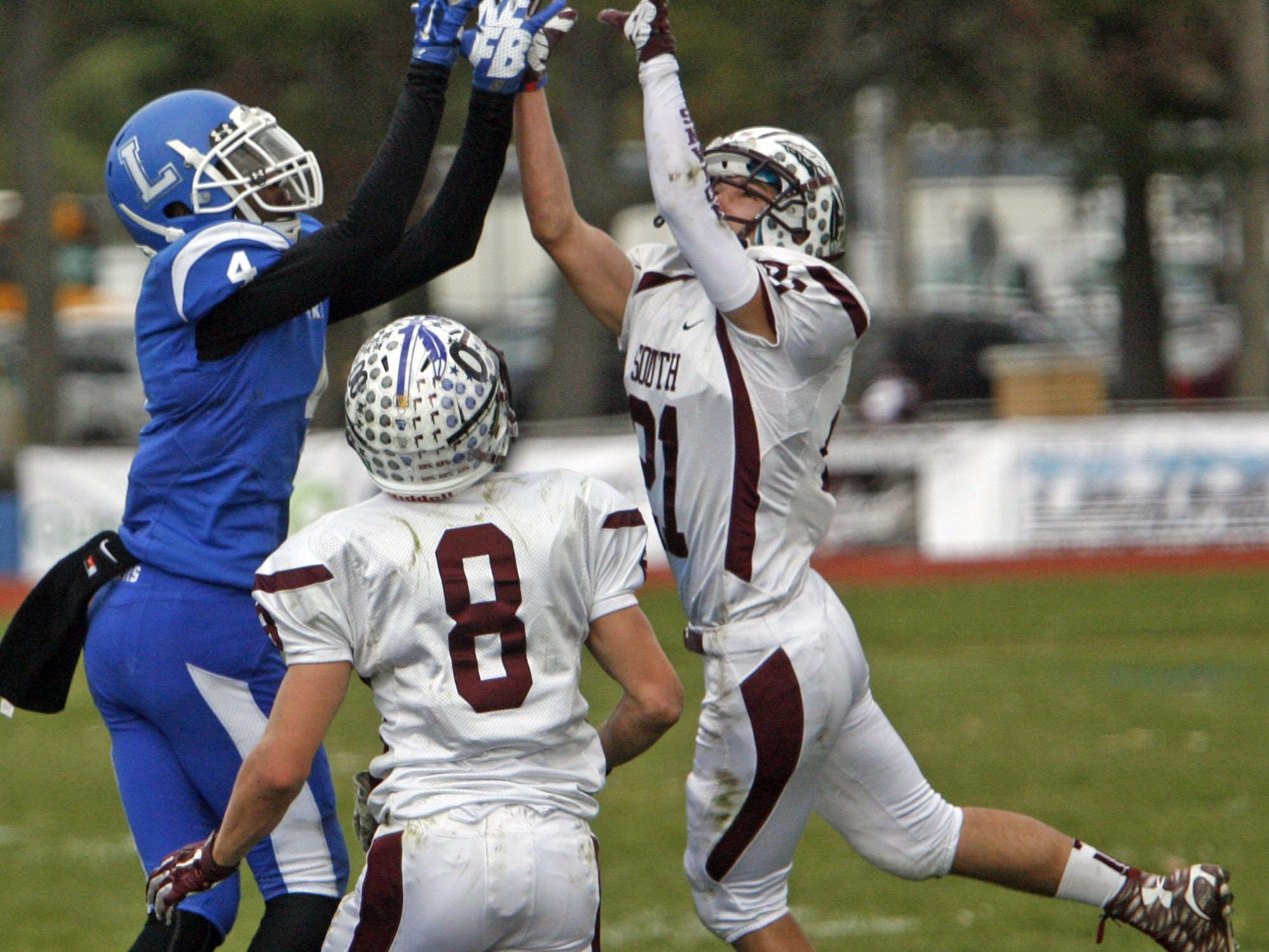 Lakewood's Jyhier Jones, left, tries to intercept an incomplete pass to TJ Rockhill of Toms River South at Lakewood High School Nov. 26, 2015. Photo by Vincent DiSalvio / Special to The ASBURY PARK PRESS