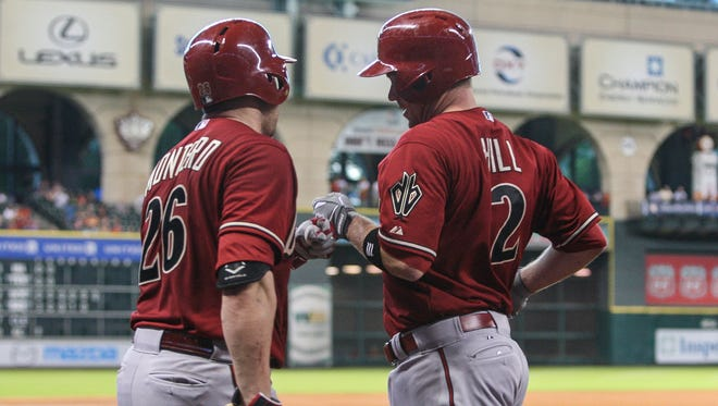 Diamondbacks second baseman Aaron Hill (2) celebrates with catcher Miguel Montero (26) after hitting a home run during the fourth inning against the Houston Astros at Minute Maid Park.