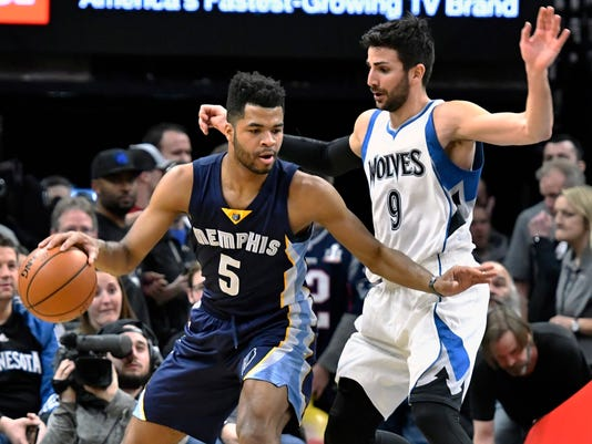 Memphis Grizzlies' Andrew Harrison, left, keeps the ball away from Minnesota Timberwolves' Ricky Rubio, of Spain, during the first quarter of an NBA basketball game Saturday, Feb. 4, 2017, in Minneapolis. (AP Photo/Jim Mone)