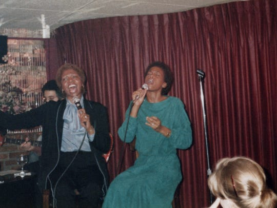 Houston (right) and her mother Cissy (left) perform in a photo featured in the documentary.