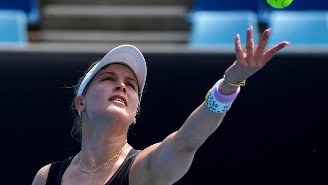 Canada's Eugenie Bouchard serves to Italy's Martina Trevisan during their women's singles qualifying match for the Australian Open tennis championship in Melbourne, Australia, Friday, Jan. 17, 2020.