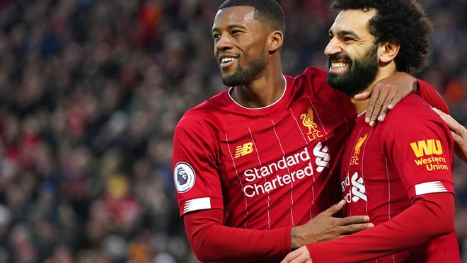 Liverpool's Mohamed Salah, right, celebrates with Liverpool's Georginio Wijnaldum after scoring his sides third goal during the English Premier League soccer match between Liverpool and Southampton at Anfield Stadium, Liverpool, England, Saturday, February 1, 2020.
