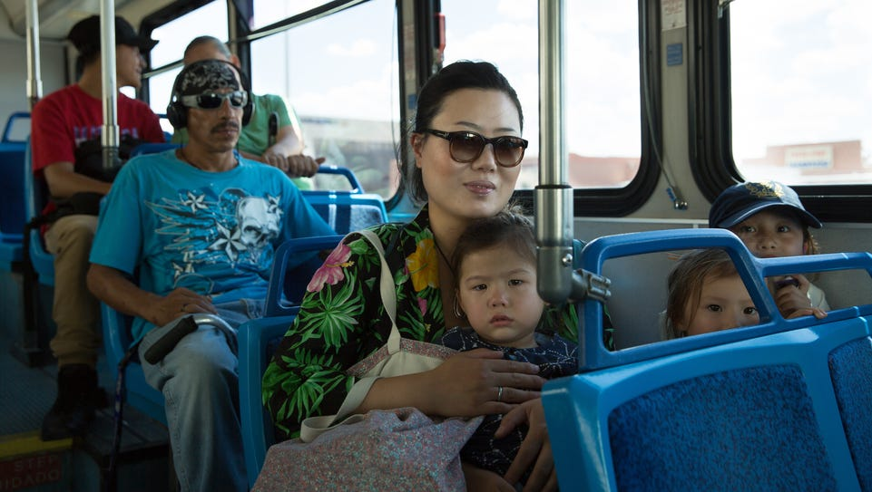 Joane Kim, right, rides the Las Cruces Roadrunner Transit,