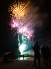 Visitors to Fort Myers Beach enjoy the fireworks on Monday.