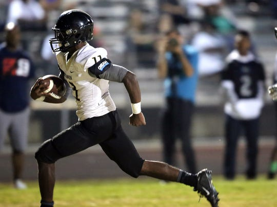 September 30, 2016 - Whitehaven senior RB Kylan Watkins (#11) sprints into the end zone for a first half score against White Station. The Tigers, ranked No. 1 in The Commercial Appeal Dandy Dozen and No. 3 in the Tennessee Class 6A state poll, looked to keep its undefeated season alive with a win Friday over the Spartans at the Fairgrounds. (Stan Carroll/The Commercial Appeal)