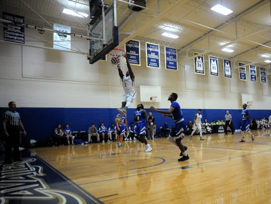 Junior Alonzo Mobley throws down a two-handed dunk