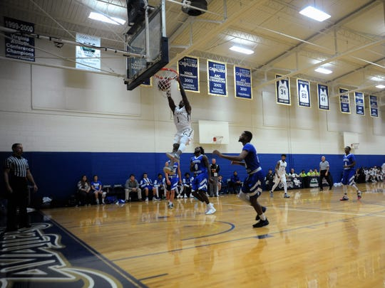 Junior Alonzo Mobley throws down a two-handed dunk for the no. 12-ranked Montreat Cavaliers during a 114-78 route of AAC foe Tennessee Wesleyan University Jan. 10.