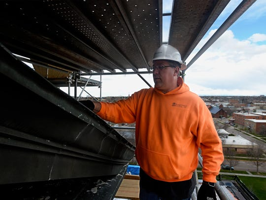Lon Gorsch of Renaissance Roofing Inc. and project manager on the Cascade County Courthouse roofing project, talks about the weather-worn copper of the old roof.