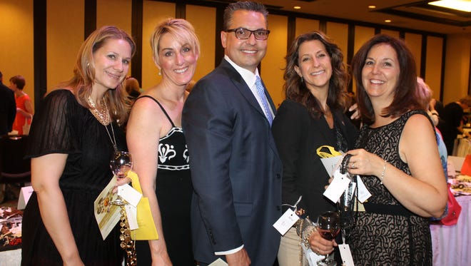 From left: Kelly Buda, Joan Padar, Steve Padar, Amie Chapman and Angela Kabisch take a moment at the jewelry fundraiser for the Women & Children's Center of the Sierra.