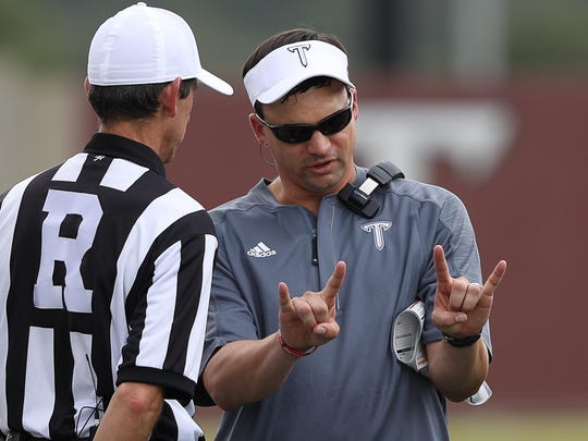 Neal Brown, leaving Troy for West Virginia, is already familiar with the Mountaineers' rivals in the Big 12 Conference. He was the offensive coordinator at Texas Tech  from 2010-12.