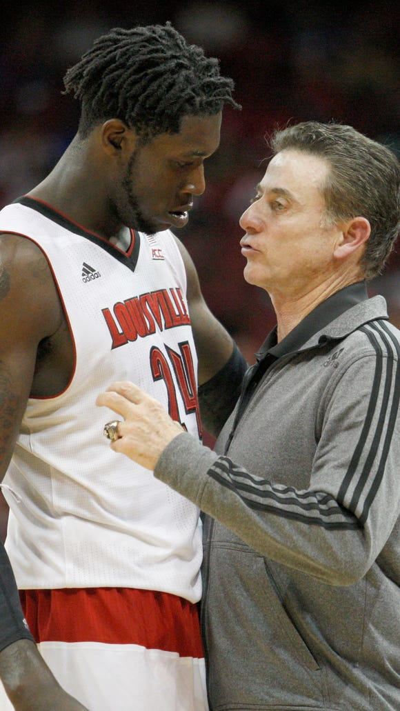 Montrezl Harrell talks with coach Rick Pitino during
