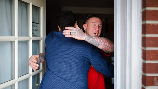 Heval Kelli and Chris Buckley embrace as they meet for the first time after almost four months of exchanging messages and phone calls.