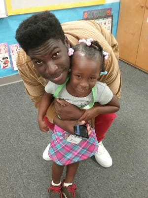 Head Start student Ty'Nikka Jones with her older brother, Jeremiah Joseph, at the Head Start Bring Your Dad to School Day.
