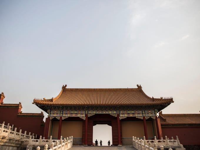 Tourists wander through the Forbidden City on Thursday,