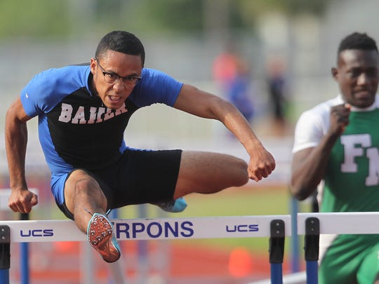 Ida Baker's Luis Colon, left, eyes the finish line during the boys 110 meter hurdles Wednesday at the District 3A-11 track and field at competition at Charlotte High School. Colon's time was 14.57.