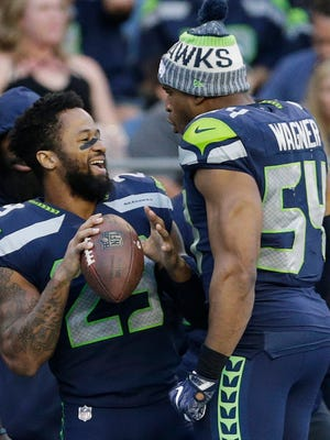 Earl Thomas, left, and Bobby Wagner see eye to eye on Thomas' contract holdout.