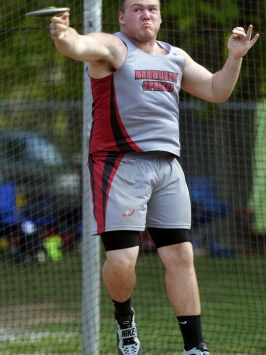 Bermudian Springs' Dustyn Lauver releases the discus at the YAIAA track and field championships Friday at Dallastown High School. Lauver won the event with a throw of 144 feet, 11 inches.