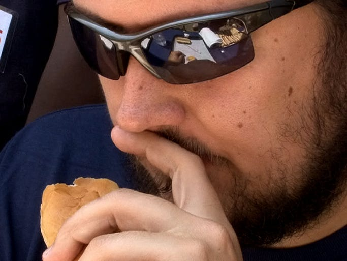 Nick Murray, Morristown, ponders his final bites during the Casino Pier hot dog eating contest held Wednesday, July 23, 2014, in Seaside Heights, NJ.  Murray won the contest, and Yankee box tickets for his girlfriend, with just over 13 hot dogs.