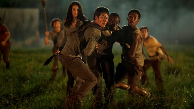 """In this image released by 20th Century Fox, from foreground left, Kaya Scoderlario, Dylan O'Brien, Aml Ameen and Jacob Latimore appear in a scene from """"The Maze Runner."""" (AP Photo/20th Century Fox, Ben Rothstein)"""